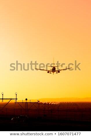 Сток-фото: посадка · плоскости · закат · землю · аэропорту · бит