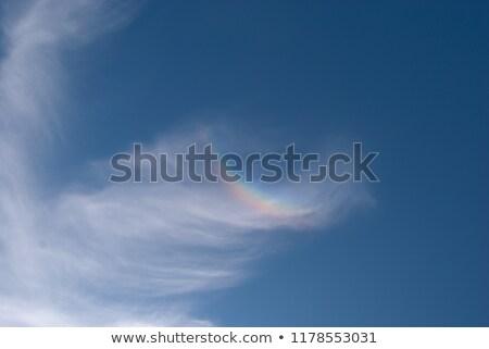 Regenboog ondersteboven bewolkt hemel boog voorjaar Stockfoto © mycola