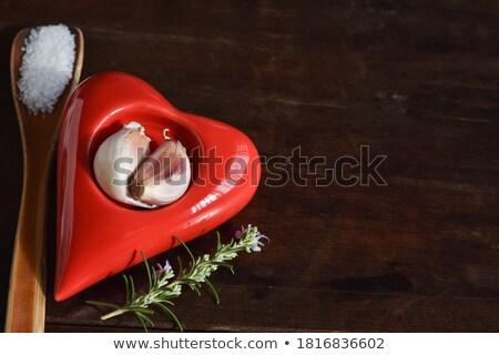 Table salt on wooden spons Stock photo © bdspn