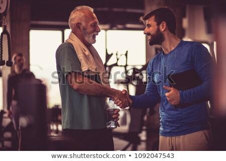Gesprek gymnasium twee mensen chat training fitness Stockfoto © JamiRae
