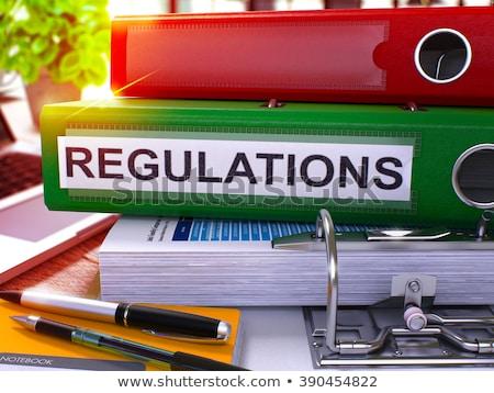 red office folder with inscription regulations stock photo © tashatuvango
