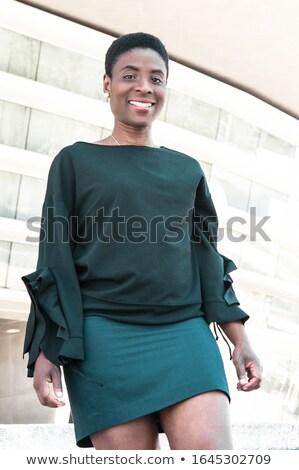 Kobieta kręcone włosy spaceru w dół schody odkryty Zdjęcia stock © deandrobot
