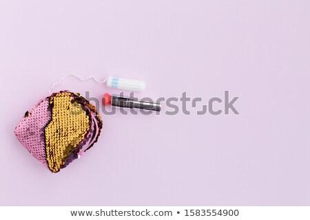 ストックフォト: Black Handbag Clutch And Purple Lipstick