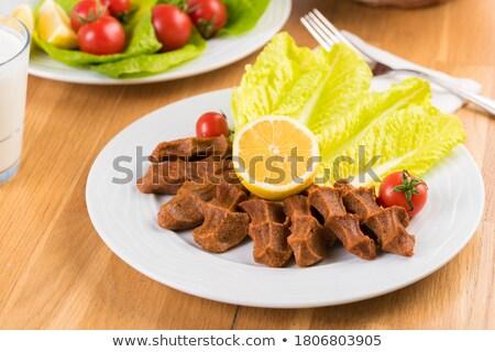 raw meatball on the plate. Stock photo © paulovilela