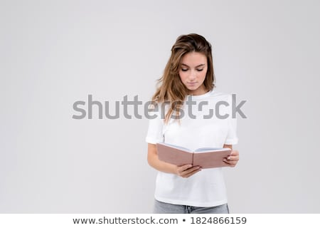 Joli femme d'affaires permanent organisateur journal accueillant Photo stock © Aikon