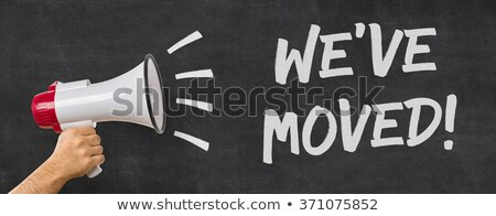 a man holding a megaphone   we have moved stock photo © zerbor