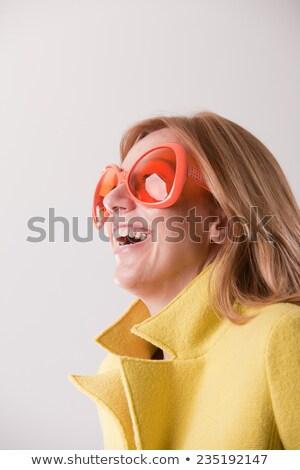 Mutlu sarışın kadın tuhaf güneş gözlüğü sarı Stok fotoğraf © Giulio_Fornasar