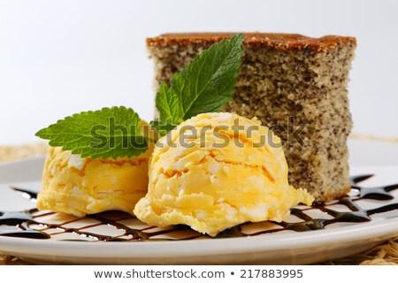 Ice cream and piece of sponge cake Stock photo © Digifoodstock