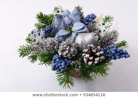 Christmas Flower Arrangement With Blue Silk Poinsettias Photo stock © TasiPas