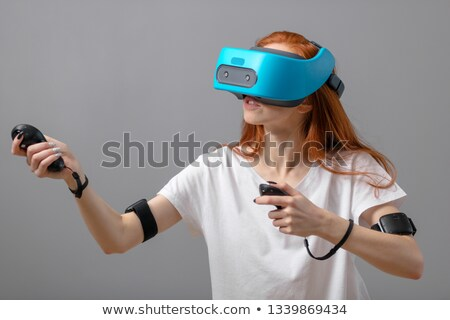 Aantrekkelijk dame virtueel realiteit hoofdtelefoon witte Stockfoto © deandrobot