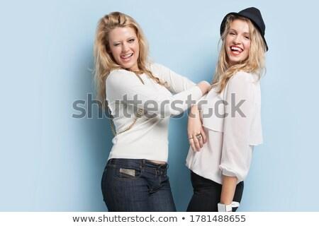 Portrait of two naughty blond women Stock photo © konradbak