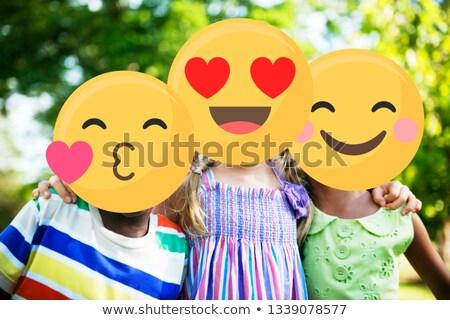 group of friends in the park. emoji face. Stock photo © wavebreak_media