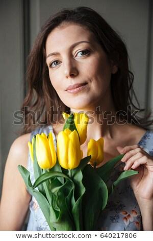 Glücklich Frau Schriftsteller Sitzung drinnen halten Stock foto © deandrobot