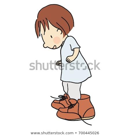 Sorridente little girl grande sapatos isolado Foto stock © julenochek