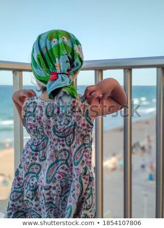 Girl drying her beach hair Stock photo © IS2