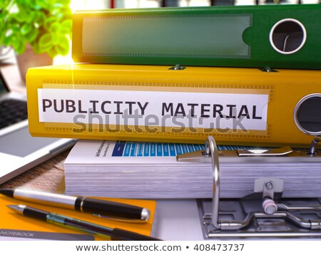 Publicity Material on Yellow Ring Binder. Blurred, Toned Image. Stock photo © tashatuvango