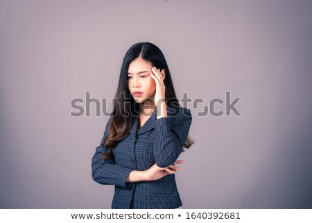 Portrait of a frustrated puzzled businesswoman in suit Stock photo © deandrobot