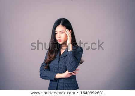 portré · tanácstalan · fiatal · üzletasszony · öltöny · szemüveg - stock fotó © deandrobot