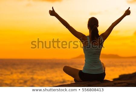 hombre · mirando · amanecer · paisaje · rezando - foto stock © blasbike