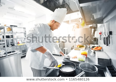 Male chef and pot on stove Stock photo © bluering