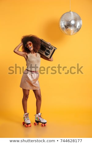 Full length portrait of a happy girl with a boombox Stock photo © deandrobot