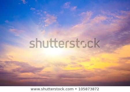 Beyaz kabarık bulutlar mavi gökyüzü gün batımı yaz Stok fotoğraf © artjazz