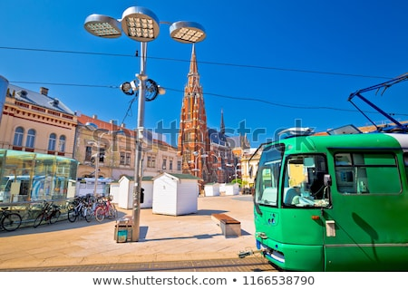 Osijek main square cathedral and tram view Stock photo © xbrchx