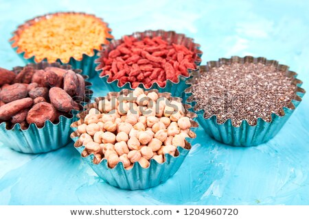 Superfoods chickpea in small bowl on blue background. Stock photo © Illia