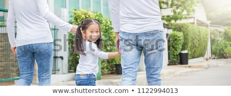 Woman Holding Her Father's Hand Stock photo © AndreyPopov