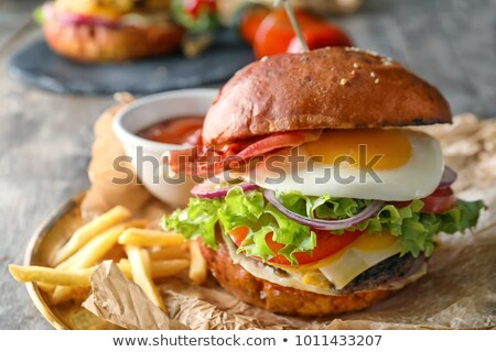 French fries and burger on parchment Stock photo © dash