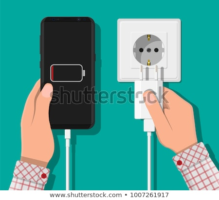 Smartphone and charger adapter. Low battery, addiction. Phone is charging from wall outlet. Flat vec Stock photo © makyzz