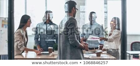 Işkadınları çalışma ofis cam tahta iş Stok fotoğraf © dolgachov