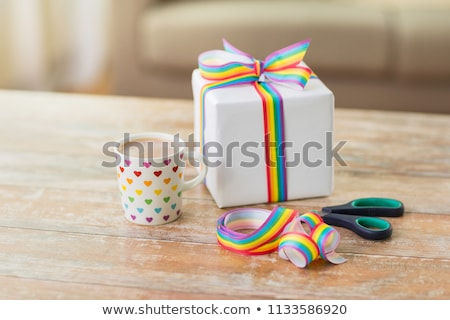 present, gay awareness ribbon and scissors Stock photo © dolgachov