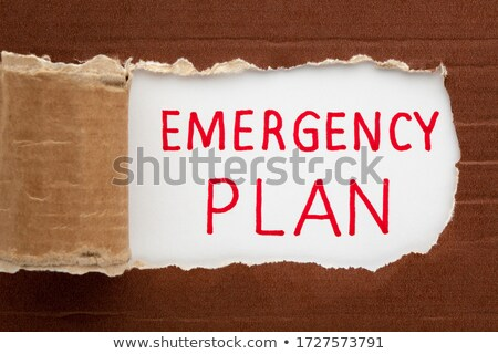 Emergency Escape Plan Torn Paper Concept Stock photo © ivelin