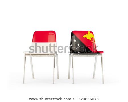 two chairs with flags of indonesia and papua new guinea stock photo © mikhailmishchenko