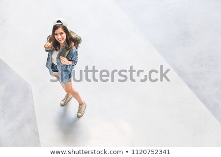 Top view of a cute young girl in summer hat Stock photo © deandrobot
