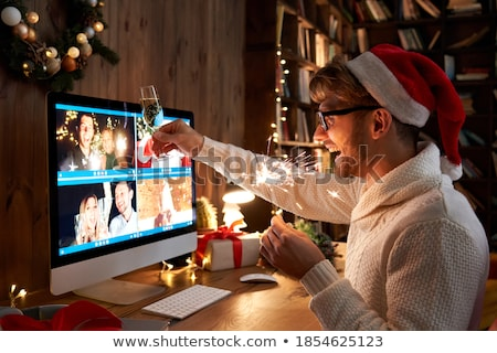 woman with glass of champagne at home on christmas Stock photo © dolgachov