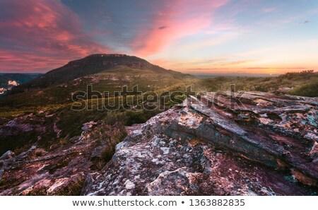 Nascer do sol feno azul montanhas nuvens vermelho Foto stock © lovleah