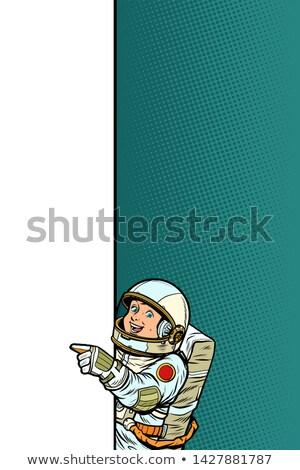 boy child son astronaut. Point to copy space poster Stock photo © studiostoks