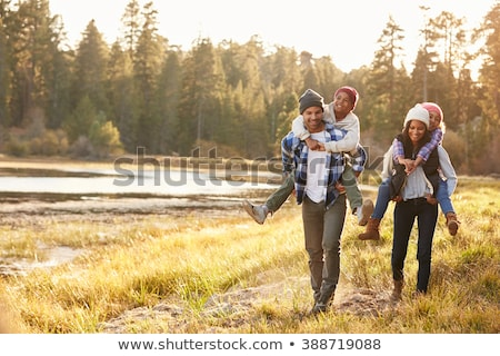 man outdoors walking in autumn landscape stock photo © monkey_business