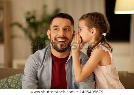 happy father whispering secret to daughter at home Stock photo © dolgachov