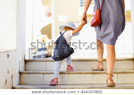 Mother and Daughter Walking in City Park Together Stock photo © robuart
