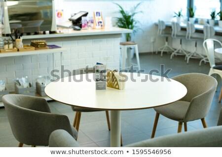 Fehér asztal prospektus papír csoport kényelmes Stock fotó © pressmaster