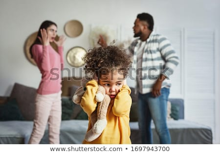 Image of emotional African American woman covers ears, yells loudly, cant stand noise demands turn o Stock photo © vkstudio