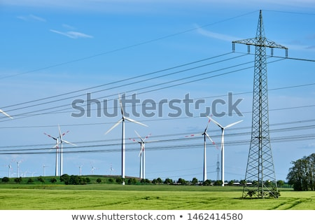 Overhead power lines and wind engines Stock photo © elxeneize