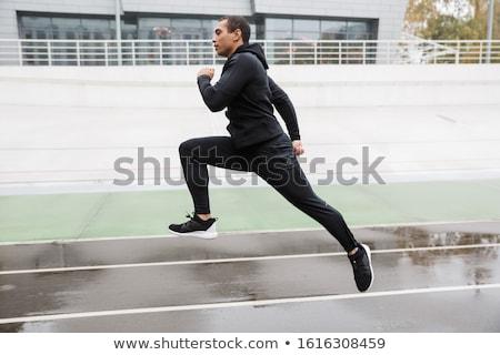 фото спортивный сильный спортсмен прыжки Сток-фото © deandrobot