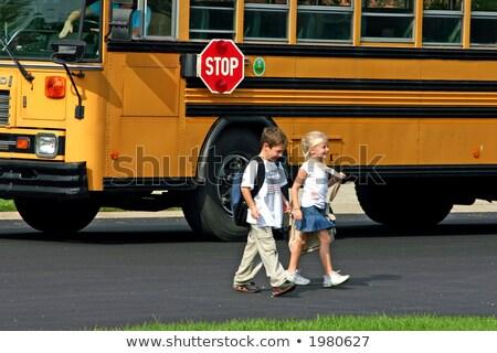 Happy children on school bus in the park Stock photo © bluering