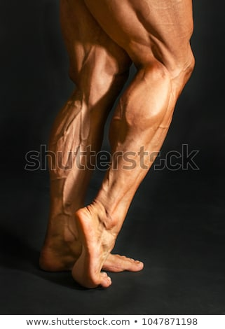 Gespierd man kalveren gymnasium oefening huid Stockfoto © Jasminko