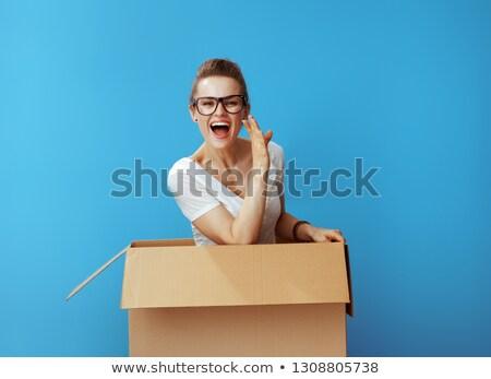 Happy woman with cardboard box. Stock photo © choreograph