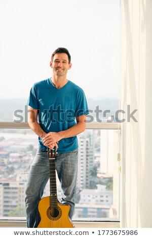Portré büszke férfi tart klasszikus gitár Stock fotó © diego_cervo
